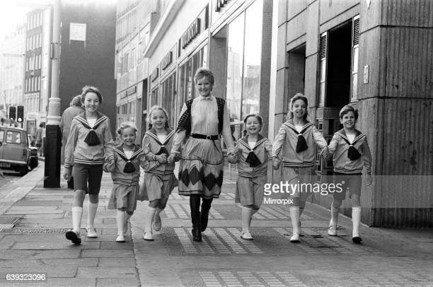 Petula Clark with one of the groups of six children in costume who will be in 'The Sound of Music' at the Apollo Theatre in Victoria, London. 26th...