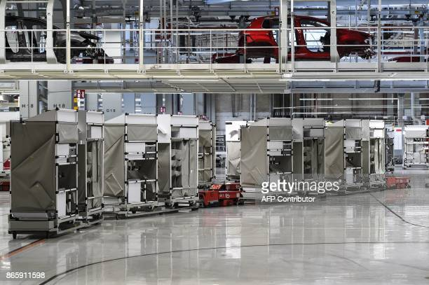 Peugeot 2008 pass over automated guided vehicles at the French auto maker PSA Peugeot Citroen factory on October 10 in Mulhouse The PSA plant in...