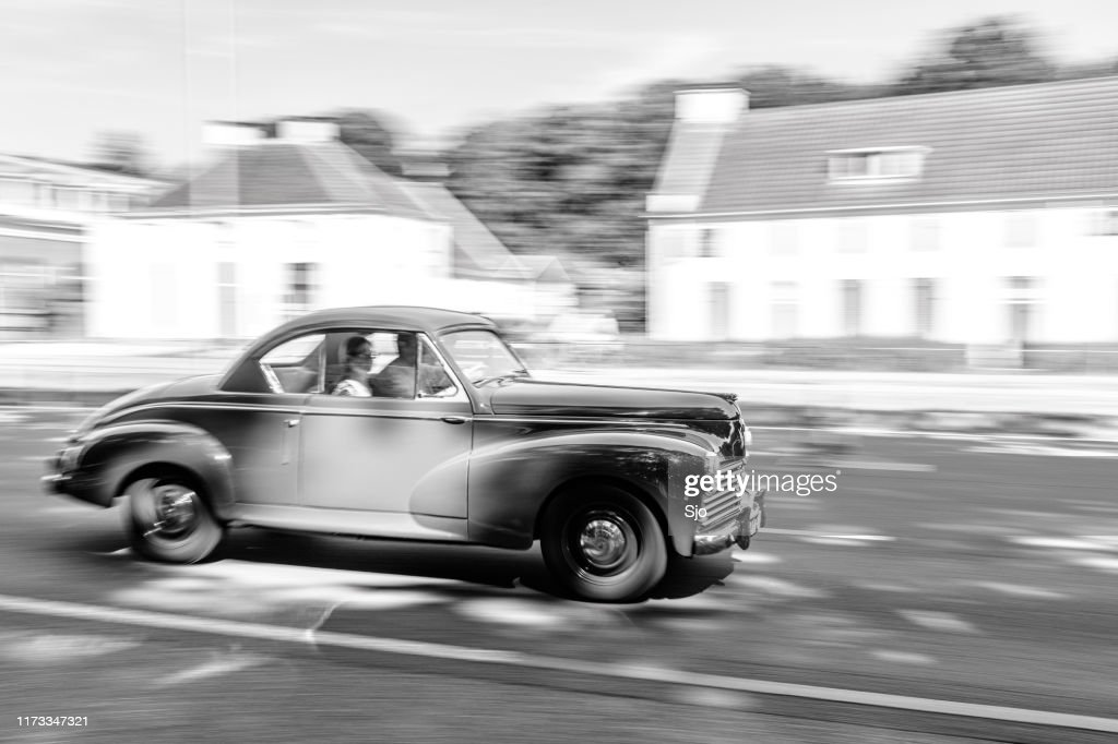 Peugeot 203 Coupe French classic 1950s car driving at high speed on a road through a forest : Stock Photo