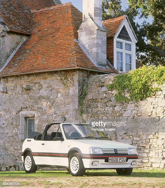 Peugeot 205 Cti in front of monastic buildings 2000
