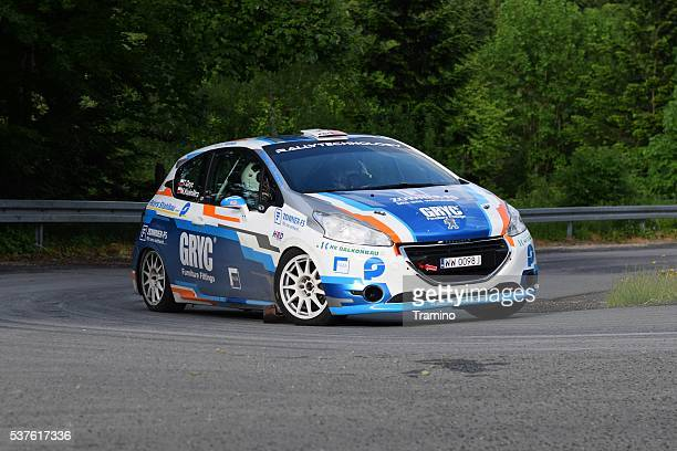peugeot 208 driving on the road - rally car stock photos and pictures