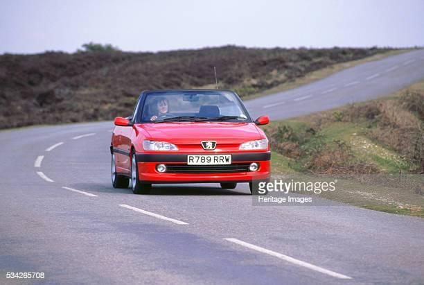 Peugeot 306 Cabriolet driving on winding road 2000