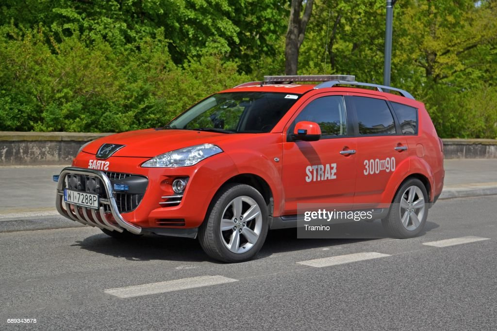 Peugeot 4007 dedicated for fire brigades parked on the street : Stock Photo
