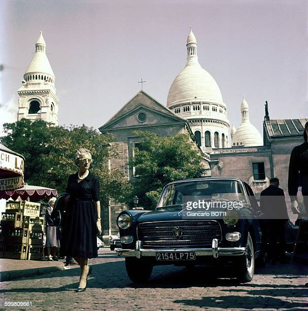 Peugeot 404 car in front of the SacréCoeur Basilica in Montmartre area in Paris France circa 1960