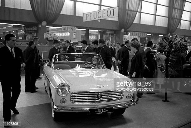 Peugeot 404 convertible in car showroom in Paris France on October 04 1962