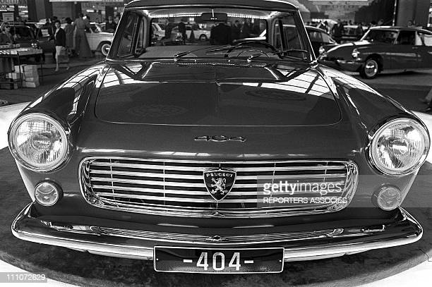 Peugeot 404 coupe in car showroom in Paris France on October 04 1962