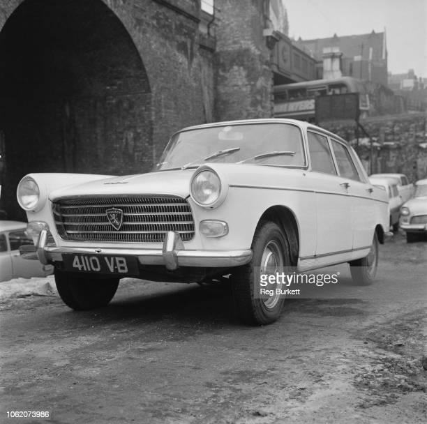 A Peugeot 404 large family car produced by French automobile manufacturer Peugeot UK 21st January 1963