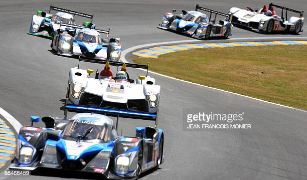 Peugeot 908 HdiFAP N°8 driven by French Franck Montagny followed by Danish Tom Kristensen with an Audi R15 TDI N°1 Portuguese Pedro Lamy with a...