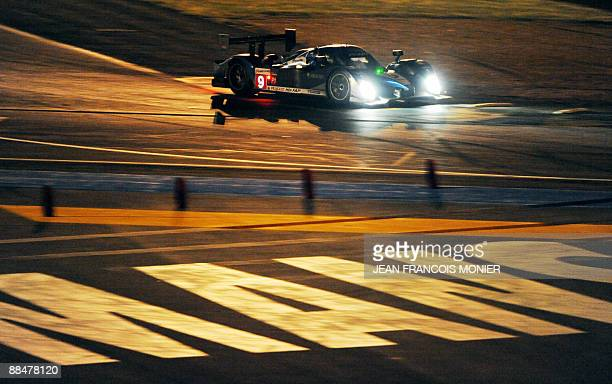 Peugeot 908 HdiFAP N°9 driven by Australian David Brabham Spanish Marco Gene and Austrian Alexander Wurz competes during the 77th edition of the Le...