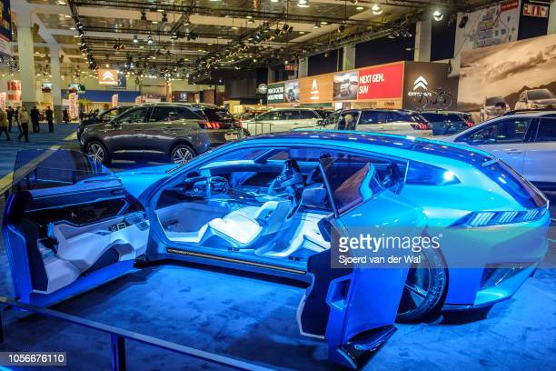 Peugeot Instinct concept car self-driving vehicle on display at Brussels Expo on January 10, 2018 in Brussels, Belgium. The Peugeot Instinct is a...