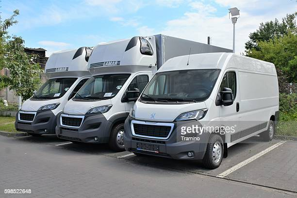 Peugeot vans in a row