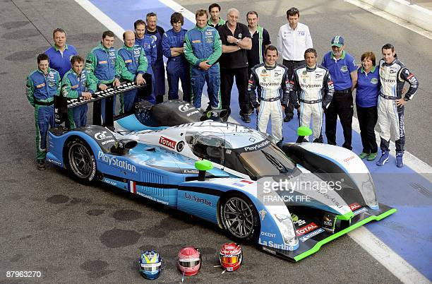 PeugeotPescarolo team's members pose on May 25 2009 on the MagnyCours racetrack central France ahead of the 24 Heures du Mans endurance race One of...
