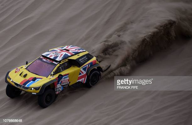 Peugeot's British driver Harry Hunt and Dutch codriver Wouter Rosegaar compete during Stage 3 of the Dakar 2019 between San Juan de Marcona and...