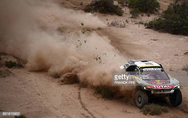 TOPSHOT Peugeot's driver Stephane Peterhansel and codriver Jean Paul Cottret compete during Stage 11 of the 2017 Dakar Rally between San Juan and Rio...