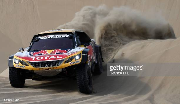 TOPSHOT Peugeot's driver Stephane Peterhansel and his codriver Jean Paul Cottret of France compete during Stage 3 of the Dakar 2018 between Pisco and...
