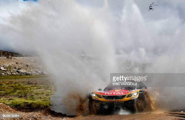 Peugeot's driver Stephane Peterhansel and his codriver Jean Paul Cottret of France compete during 2018 Dakar Rally Stage 6 between Arequipa and La...