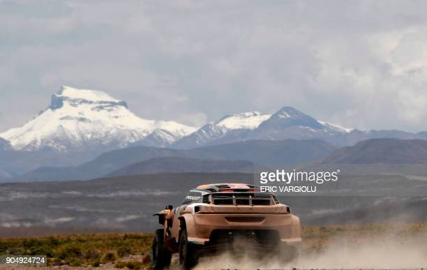 TOPSHOT Peugeot's driver Stephane Peterhansel and his codriver Jean Paul Cottret of France compete during Stage 8 of the 2018 Dakar Rally between...