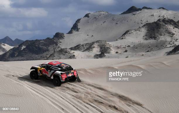 Peugeot's French driver Cyril Despres and codriver David Castera of France compete during the Stage 11 of the 2018 Dakar Rally between Belen and...