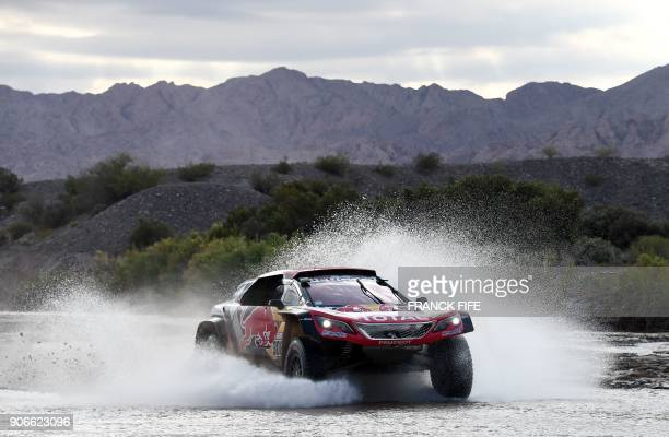 Peugeot's French driver Cyril Despres and codriver David Castera of France compete during the Stage 12 of the 2018 Dakar Rally between Chilecito and...