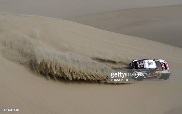 TOPSHOT Peugeot's French driver Sebastien Loeb and codriver Daniel Elena compete during Stage 3 of the Dakar 2018 between Pisco and San Juan de...
