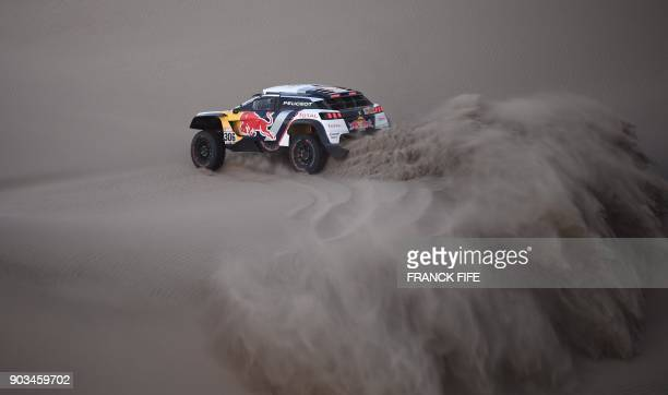 Peugeot's French driver Sebastien Loeb and co-driver Daniel Elena from Monaco compete before being forced to abandon after running into sand trouble...