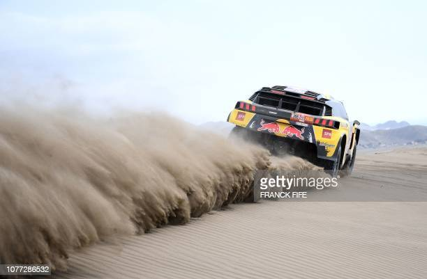 TOPSHOT Peugeot's French driver Sebastien Loeb and codriver Daniel Elena of Monaco take part in a driving session in San Bartolo 75 km south of Lima...