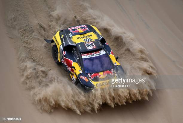 TOPSHOT Peugeot's French driver Sebastien Loeb and codriver Daniel Elena of Monaco compete during Stage 1 of the Dakar 2019 between Lima and Pisco...