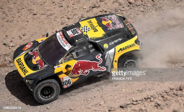 Peugeot's French driver Sebastien Loeb and codriver Daniel Elena of Monaco arrive in Tacna Peru at the end of the Dakar Rally Stage 4 between...