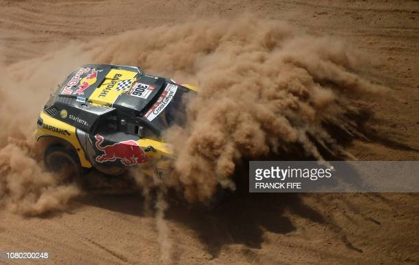 Peugeot's French driver Sebastien Loeb and co-driver Daniel Elena of Monaco compete in the Dakar Rally Stage 4 between Arequipa and Tacna, in Peru,...