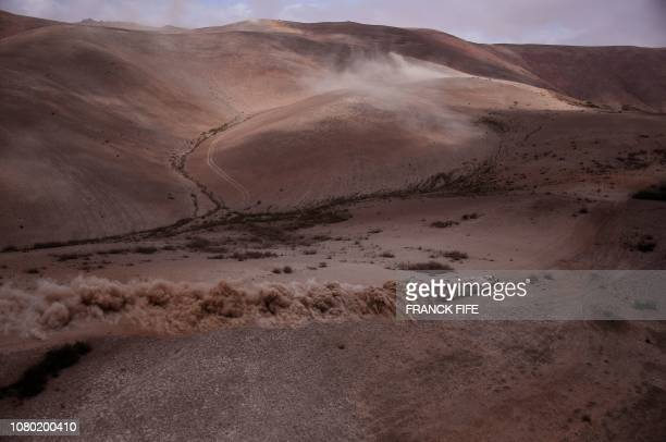 Peugeot's French driver Sebastien Loeb and codriver Daniel Elena of Monaco compete in the Dakar Rally Stage 4 between Arequipa and Tacna in Peru on...