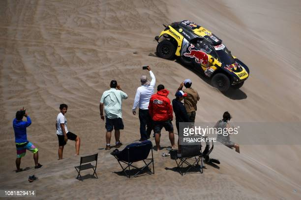 Peugeot's French driver Sebastien Loeb and codriver Daniel Elena of Monaco compete during the Stage 6 of the Dakar Rally between Arequipa and San...