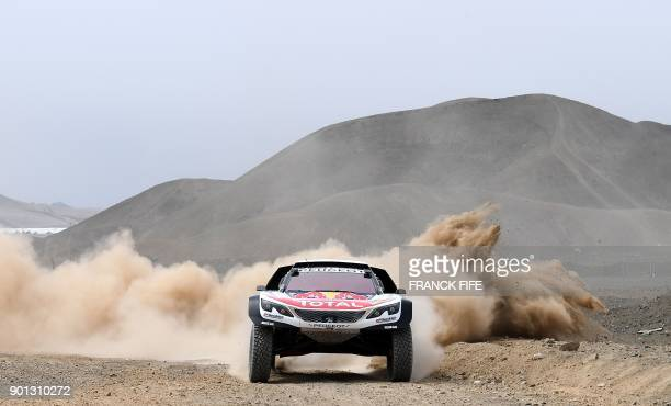 Peugeot's French driver Sebastien Loeb and codriver Daniel Elena of Monaco take part in a driving session on the eve of technical checkup in San...
