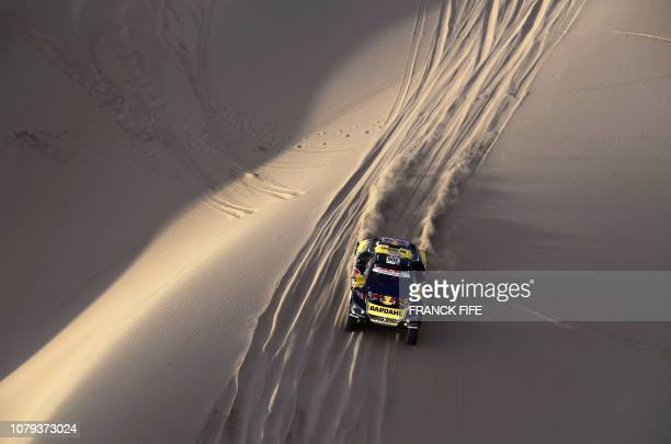 Peugeot's French driver Sebastien Loeb and codriver Daniel Elena compete during the Stage 2 of the Dakar 2019 between Pisco and San Juan de Marcona...