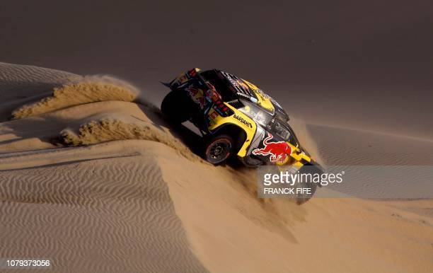 TOPSHOT Peugeot's French driver Sebastien Loeb and codriver Daniel Elena compete during the Stage 2 of the Dakar 2019 between Pisco and San Juan de...