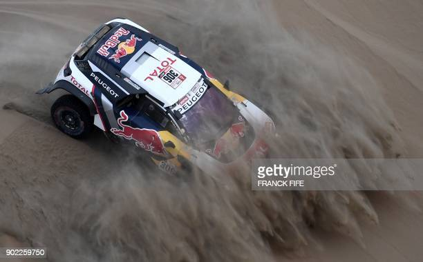 TOPSHOT Peugeot's French driver Sebastien Loeb and Monaco's codriver Daniel Elena compete during the 2018 Dakar Rally Stage 2 in and around the...
