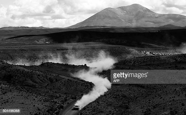 Peugeot's French driver Stephane Peterhansel and codriver Jean Paul Cottret compete during the Stage 7 of the Dakar Rally 2016 from Uyuni Bolivia to...