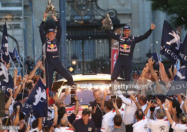 Peugeot's French driver Stephane Peterhansel and codriver Jean Paul Cottret celebrate their victory on the podium of the 2017 Rally Dakar in Buenos...