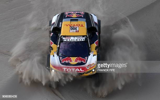 TOPSHOT Peugeot's French driver Stephane Peterhansel and codriver Jean Paul Cottret compete during the 2018 Dakar Rally's Stage 11 between Belen and...