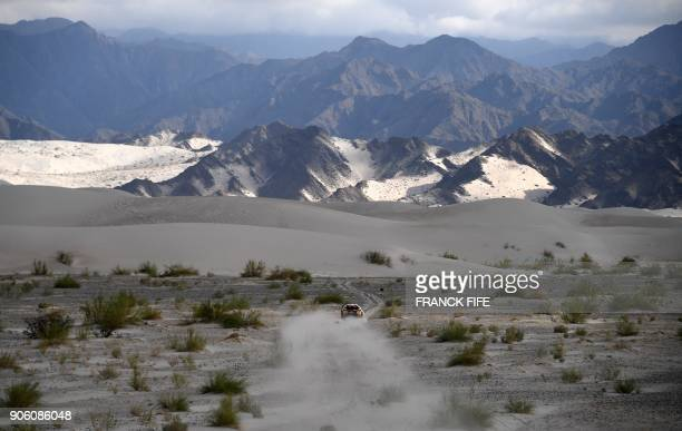 Peugeot's French driver Stephane Peterhansel and codriver Jean Paul Cottret compete during the 2018 Dakar Rally's Stage 11 between Belen and...