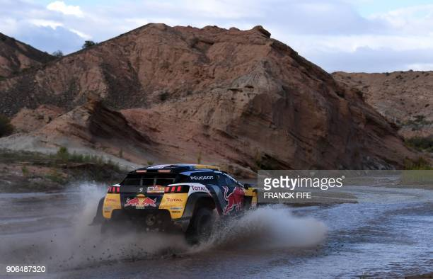 Peugeot's French driver Stephane Peterhansel and codriver Jean Paul Cottret of France compete during the Stage 12 of the 2018 Dakar Rally between...