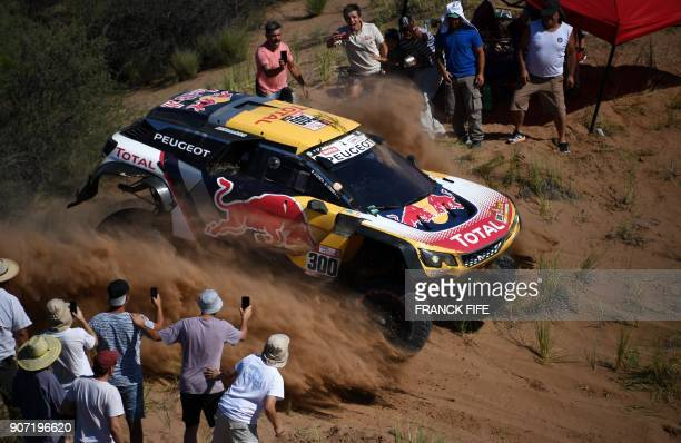 Peugeot's French driver Stephane Peterhansel and codriver Jean Paul Cottret compete during the 2018 Dakar Rally between San Juan and Cordoba in...