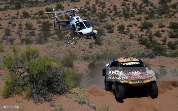 TOPSHOT Peugeot's French driver Stephane Peterhansel and codriver Jean Paul Cottret compete during the 2018 Dakar Rally between San Juan and Cordoba...
