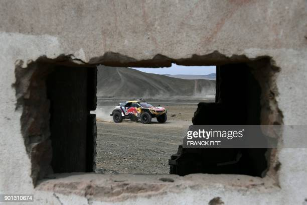 Peugeot's French driver Stephane Peterhansel and his codriver Jean Paul Cottret of France take part in a driving session on the eve of technical...