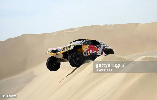 Peugeot's French driver Stephane Peterhansel and his codriver Jean Paul Cottret of France compete during the Stage 1 of the 2018 Dakar Rally between...