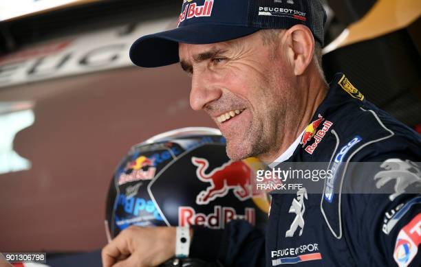 Peugeot's French driver Stephane Peterhansel is pictured before a driving session on the eve of technical checkup in San Bartolo 75 km south of Lima...