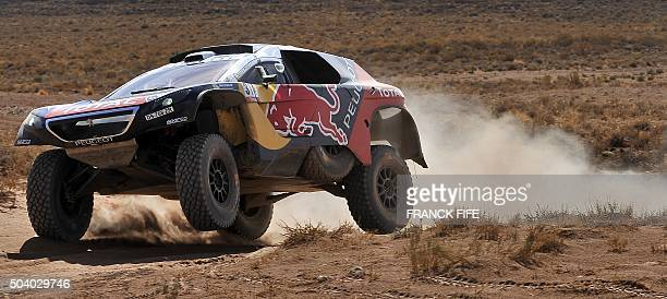 Peugeot's French drivers Sebastien Loeb and Daniel Elena compete during Stage 6 of the Dakar 2016 around Uyuni Bolivia on January 8 2016 Peterhansel...