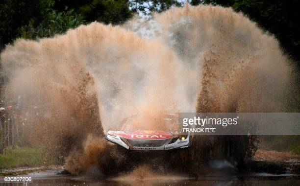 TOPSHOT Peugeot's pilot Sebastien Loeb and copilot Daniel Elena both from France compete during the 2017 Dakar Rally Stage 1 between Asuncion and...