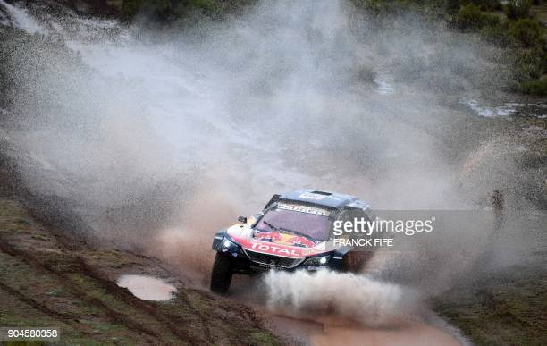 TOPSHOT Peugeot's Spanish driver Carlos Sainz and codriver Lucas Cruz compete during Stage 7 of the 2018 Dakar Rally between La Paz and Uyuni Bolivia...