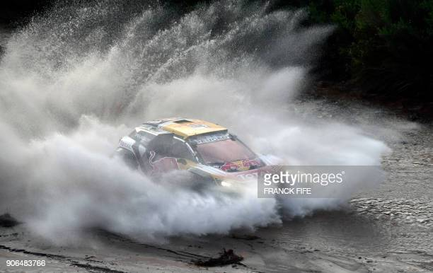TOPSHOT Peugeot's Spanish driver Carlos Sainz and codriver Lucas Cruz of Spain compete during the Stage 12 of the 2018 Dakar Rally between Chilecito...