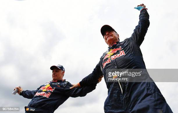 Peugeot's Spanish driver Carlos Sainz and codriver Lucas Cruz of Spain celebrate after winning the Dakar Rally 2018 at the end of the last stage in...